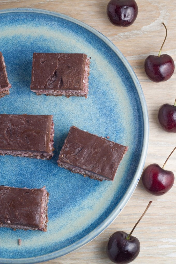 Raw cherry ripe slice. Inspired by the popular chocolate bar but SO MUCH HEALTHIER and really tasty too! Includes a nut free base option.