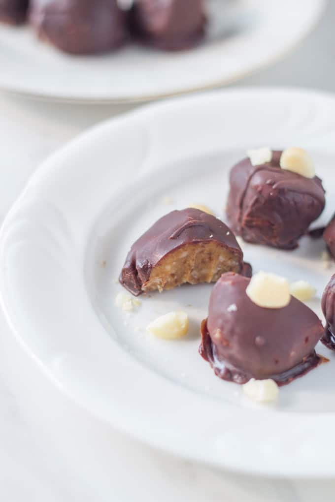 Raw Chocolate Caramel Macadamia Truffles. Make the perfect after dinner treat! They are delicious and look amazing! Your guests won't believe that you actually made them.