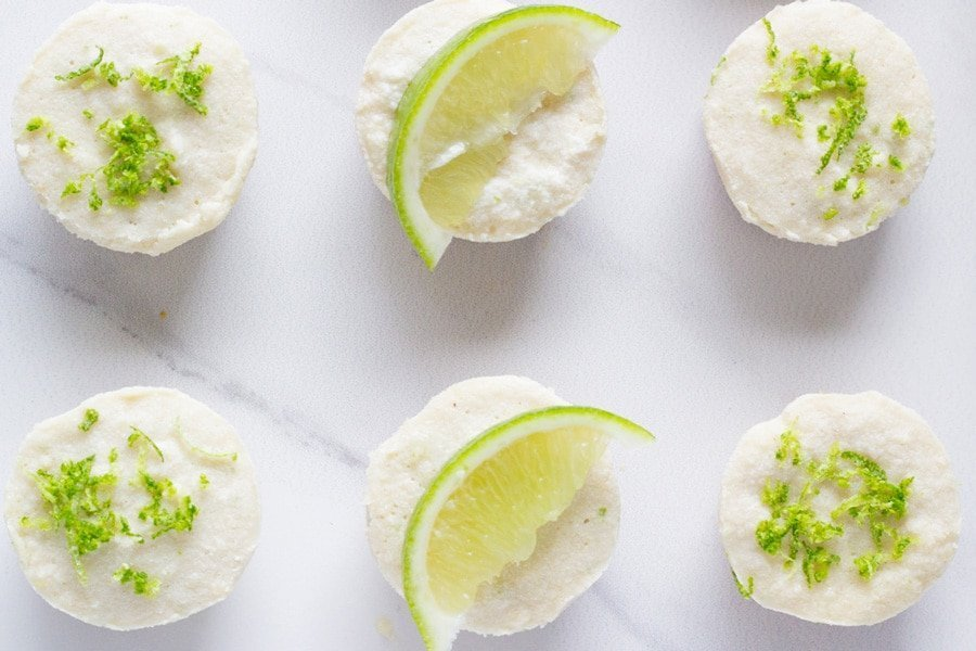Raw Mini Lime Cheesecakes. These amazing mini desserts are made with lime essential oil and are so delicious. They will not last long once you make them!